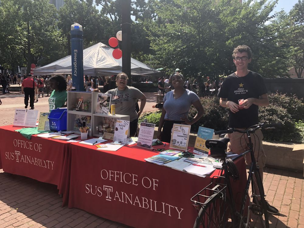 Four students tabling at an event.