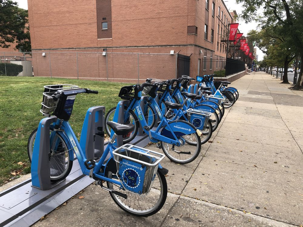 Picture of blue Indego bikeshare station at Broad Street and Diamond Ave.