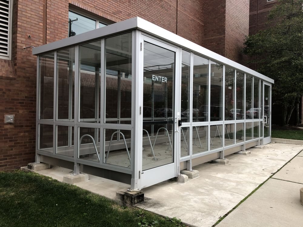 Picture of the locked bicycle parking structure located on the north side of the Engineering Building.